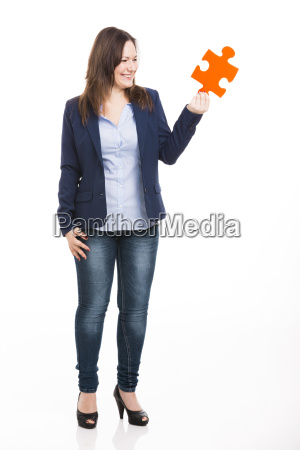 business woman holding a puzzle piece