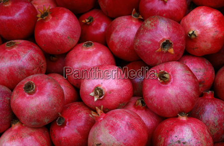 fresh red ripe pomegranates at retail