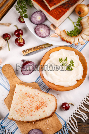 slice of bread with lard spread