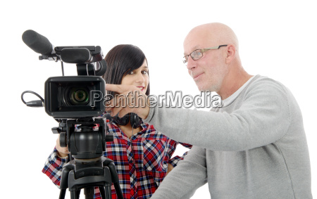 young woman cameraman and the mature