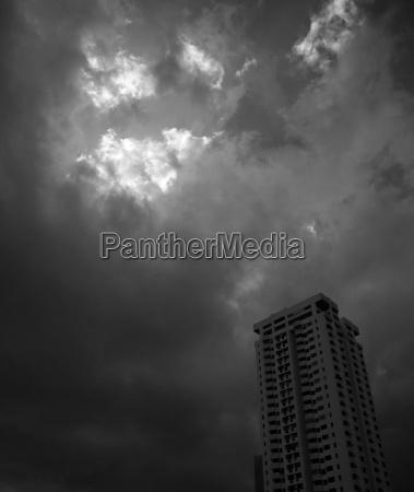 a building with dark stormy sky