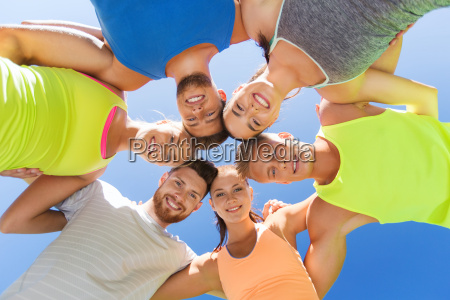 group of happy sporty friends in