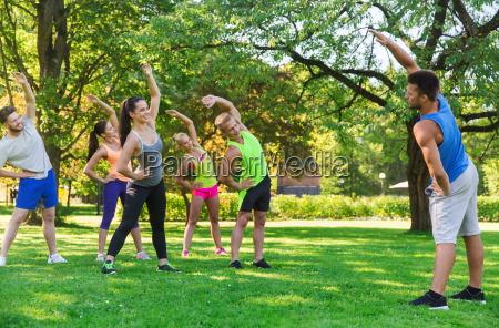 group of friends or sportsmen exercising