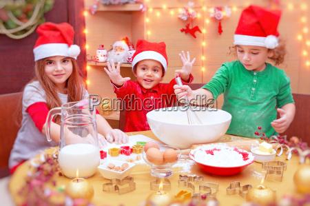 happy children making cookies
