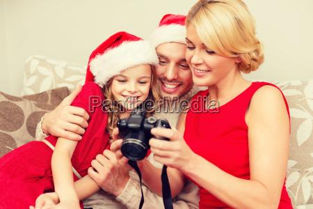family in santa helper hats looking