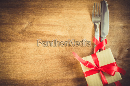 present and cutlery decorated with red