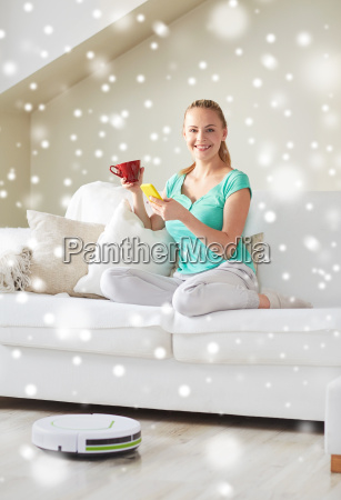 happy woman with smartphone drinking tea