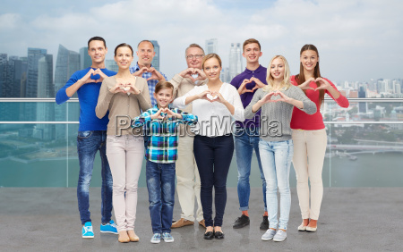 people showing heart hand sign over