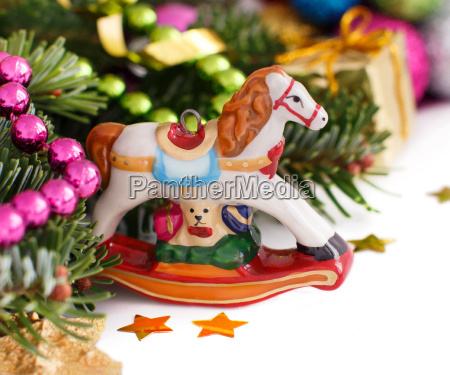 festive decorations with rocking horse