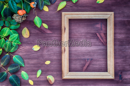 empty wooden frame on brown wood