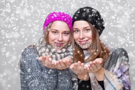 twin sisters dressed in warm winter