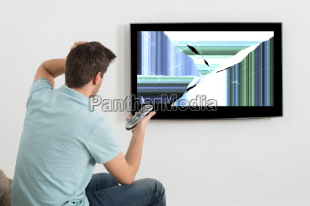 man sitting on sofa in front