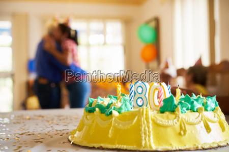 celebration 80 birthday party daughter hugging