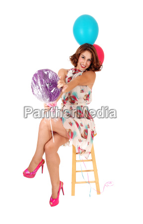 happy woman with two balloons