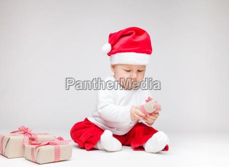 adorable baby wearing a santa hat