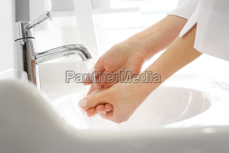 the doctor washes his hands the