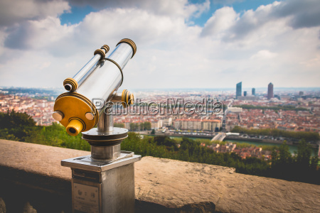 telescope directed towards the city of