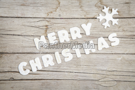 weihnachtlicher gray wooden background with merry