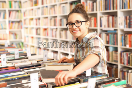 the girl chooses a book in