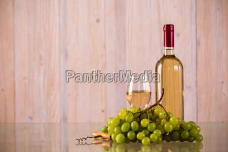 bottle of white wine with grapes