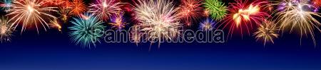 colorful firework display in panoramic format