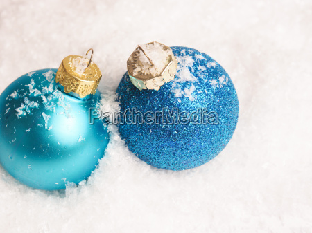 two blue christmas baubles