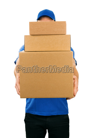 delivery man holding pile of cardboard