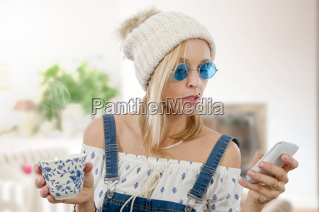 pretty blond woman with a cup