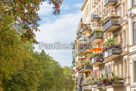 traditional european balcony with colorful flowers