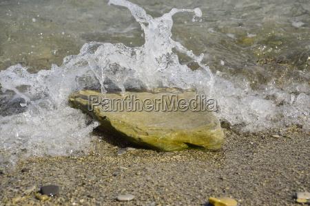 sea waves run ashore bubbling and