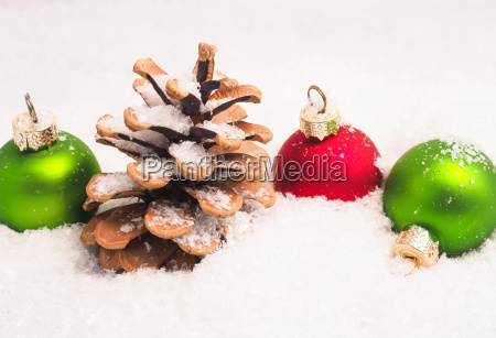 vintage christmas baubles in snow