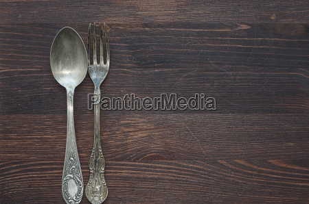 old spoon and fork on brown