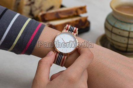 wrist watches on girls hand at