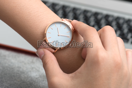girls hand with wrist watch in