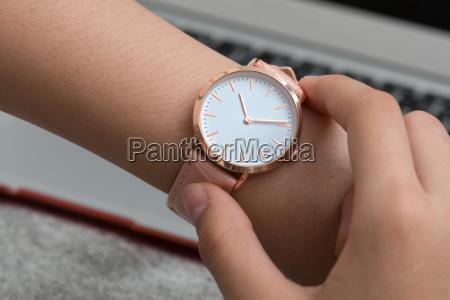 wrist watch on girls hand in