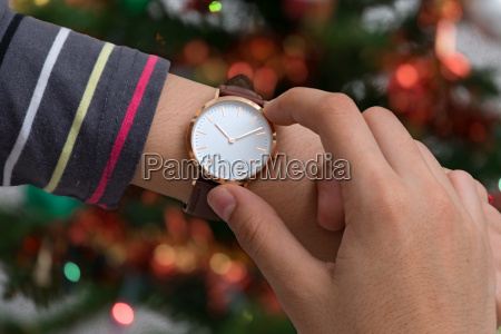 girls hand with wrist watches at