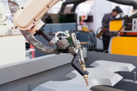 industrial welding robot arm in the