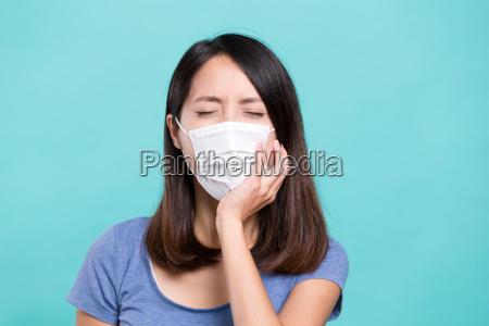 woman feeling toothache