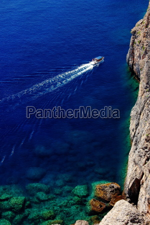 cliff view with boat