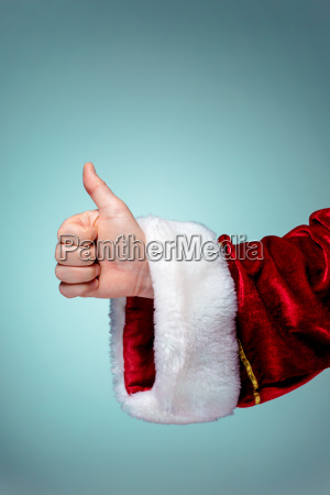 santa claus hand showing thumbs up