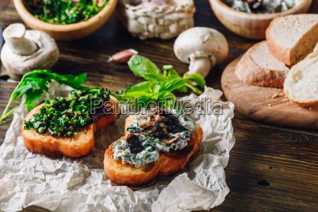 italian bruschettas with mushroom and greens