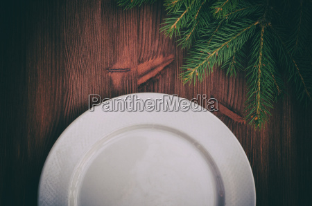 half of an empty white plate