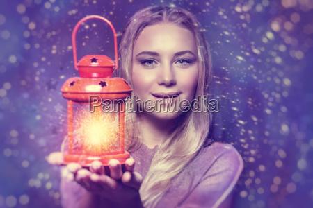 beautiful woman with glowing lantern