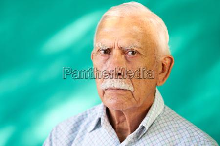 real people portrait sad elderly hispanic