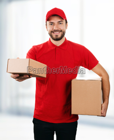 delivery service young smiling deliveryman