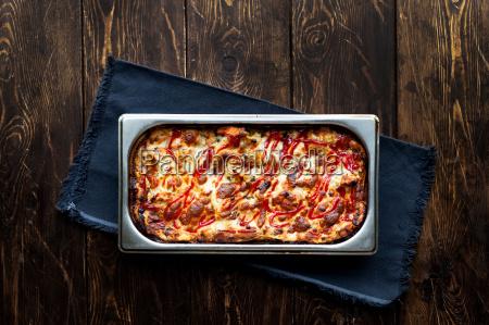 hot tasty lasagna in ceramic casserole