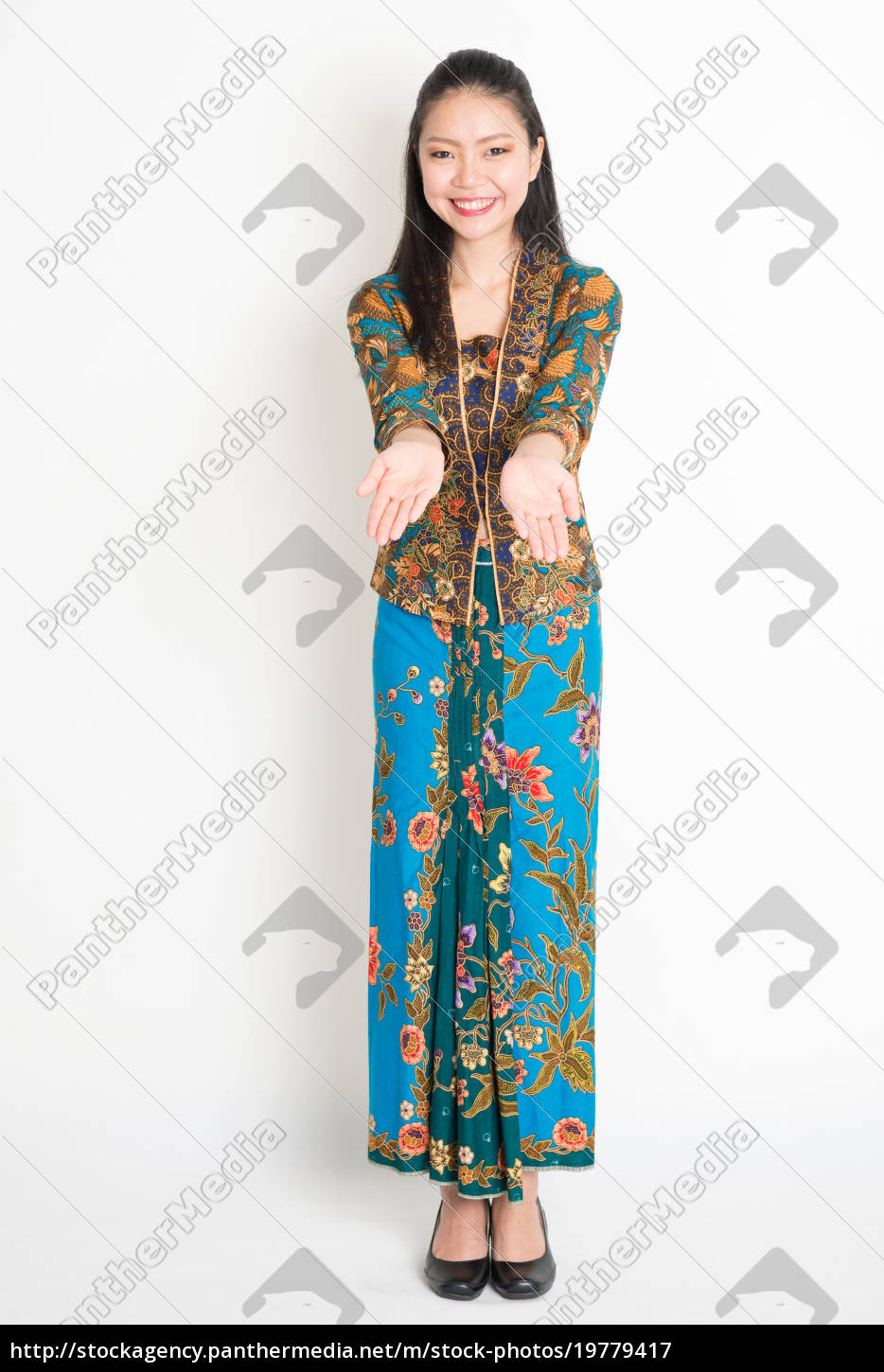 f0526a10b Southeast Asian girl hand showing something - Royalty free image ...