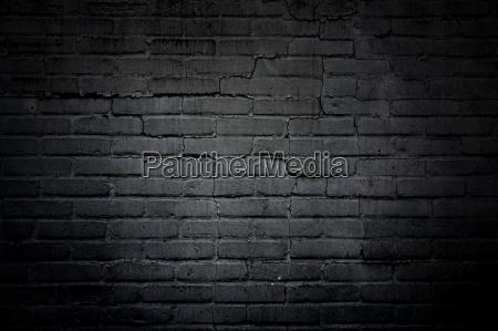 menacing dark stone wall