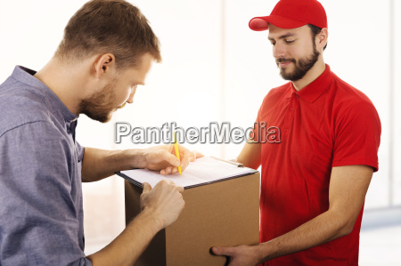 delivery service man signing delivery