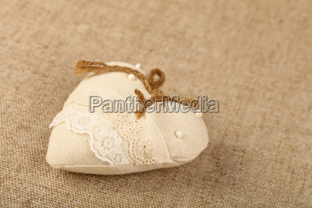 white beige toy heart with lace